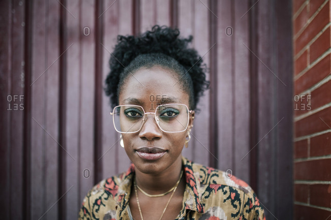 Portrait of young black woman with glasses looking at camera