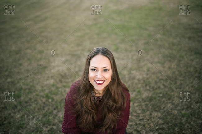 Portrait of young caucasian woman with long hair in the city