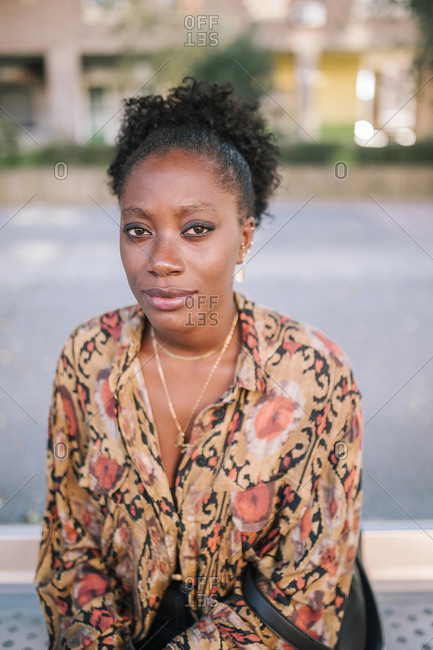 Portrait of young black woman looking at camera in the city