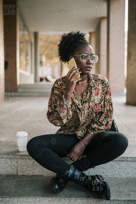 Black woman talking on her mobile phone in the city