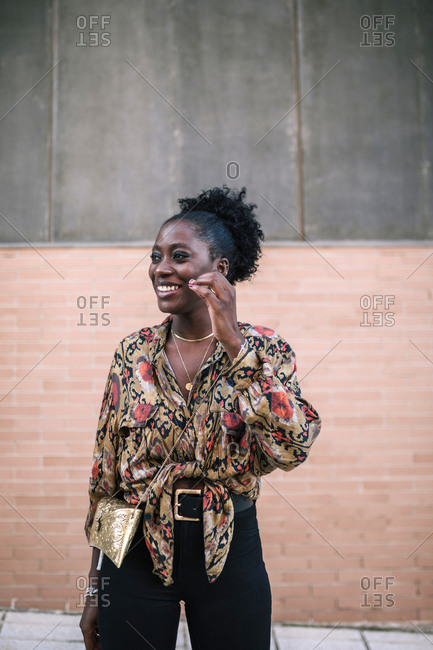 Portrait of young black woman smiling in the city