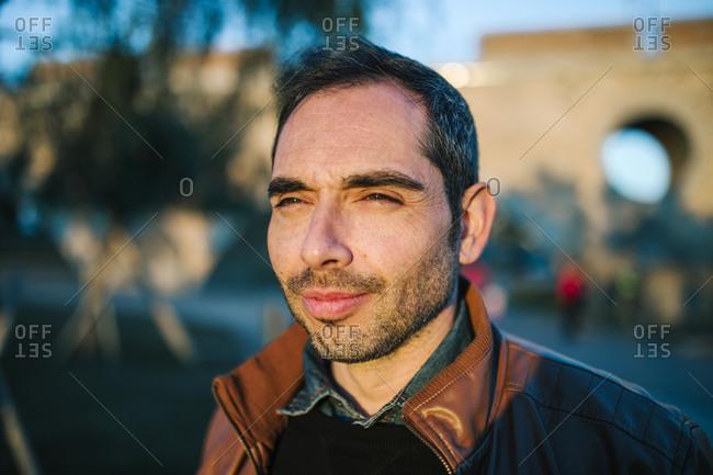 Portrait of Caucasian man smiling in a city park