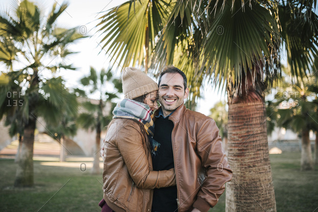 Happy loving couple in a city park in spain
