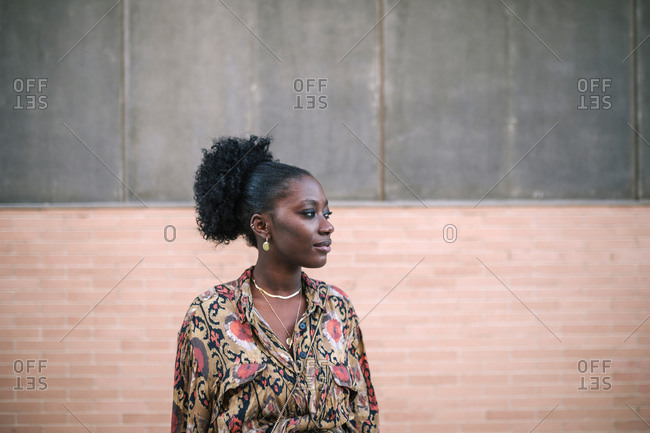 Portrait of young black woman in the city