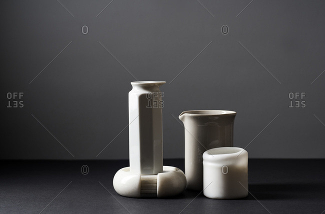 Still life with white shapes on gray background