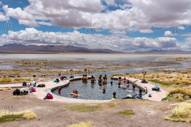 February 18, 2020: People enjoying the hot springs in the Bolivian altiplano, Potosi, Bolivia