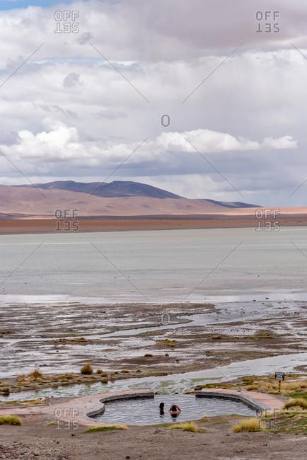 February 18, 2020: People enjoying the hot springs in the Bolivian altiplano. Sud Lipez province, Potosi, Bolivia