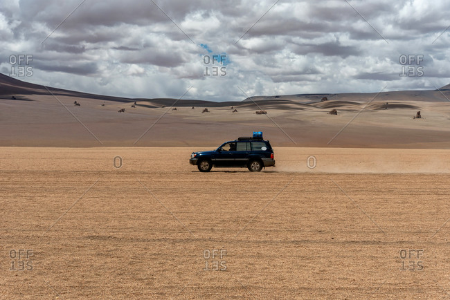A 4x4 driving through the southwest of the altiplano in Bolivia
