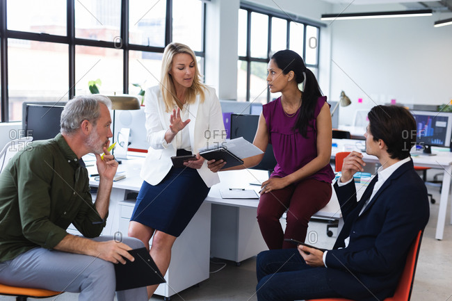 Group of diverse business people brainstorming in modern office