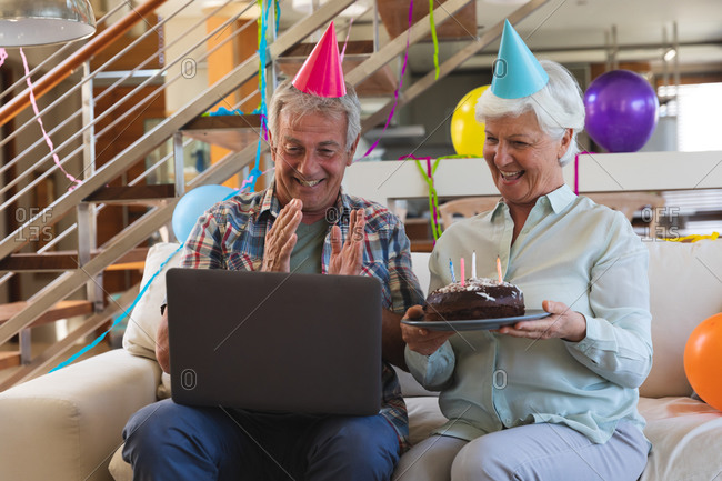 Senior caucasian couple on video call celebrating birthday