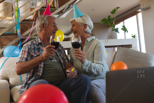 Senior caucasian couple on video call celebrating birthday
