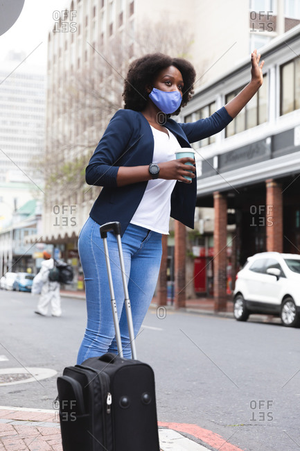African american woman wearing face mask in street