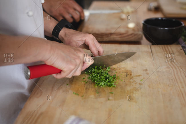 Female chef and mixed race male chef in kitchen