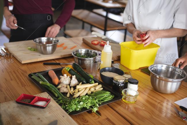 Female chef and caucasian male chef in kitchen