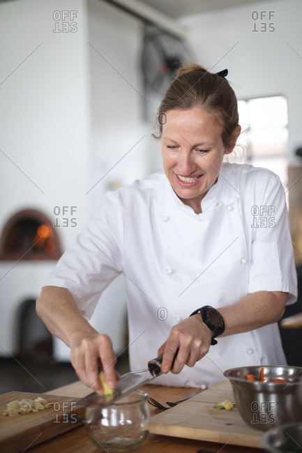 Caucasian female chef cooking in kitchen
