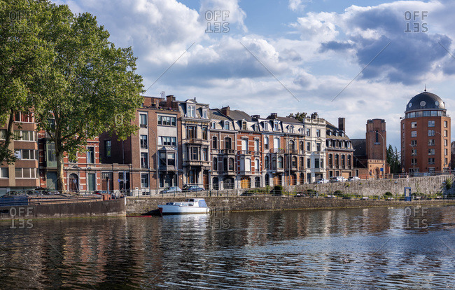 Belgium- Liege Province- Liege- City canal stretching in front of row of townhouses