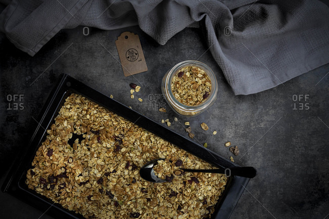 Pan of homemade granola with pumpkin seeds- cranberries and wholegrain oat flakes