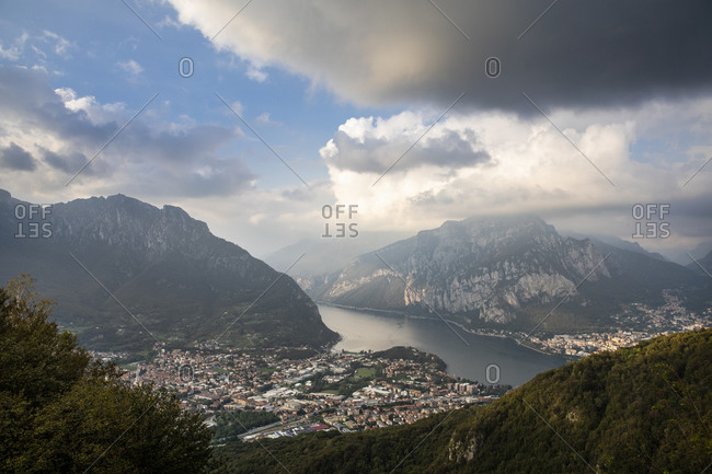 Scenic view of cityscape with Lake Como and mountains against sky at sunset