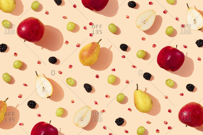 Pattern of fresh apples- pears- grapes- blackberries and pomegranate seeds