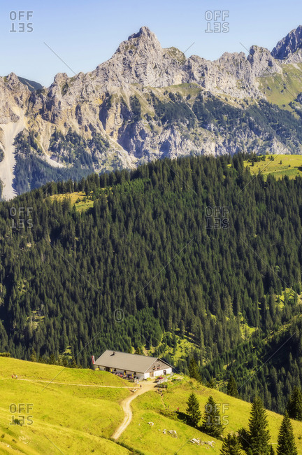 Scenic view of hot overlooking forested Tannheimer Tal valley