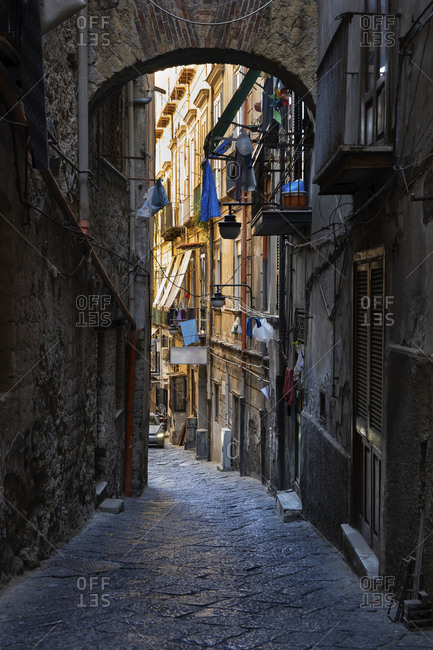 Italy- Campania- Naples- Narrow alley along old city houses