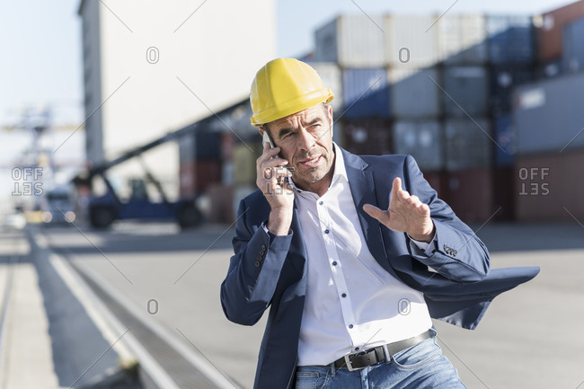 Portrait of businessman on the phone at industrial site