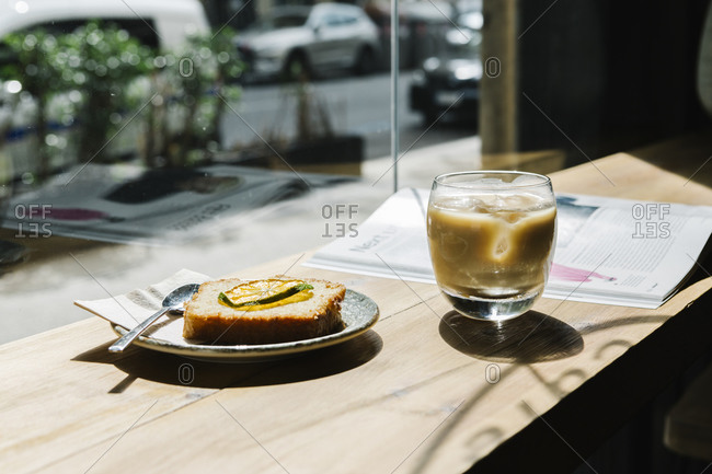 Cold brew coffee and cake on table at coffee shop