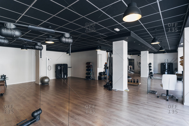 Empty gym with various exercise equipment