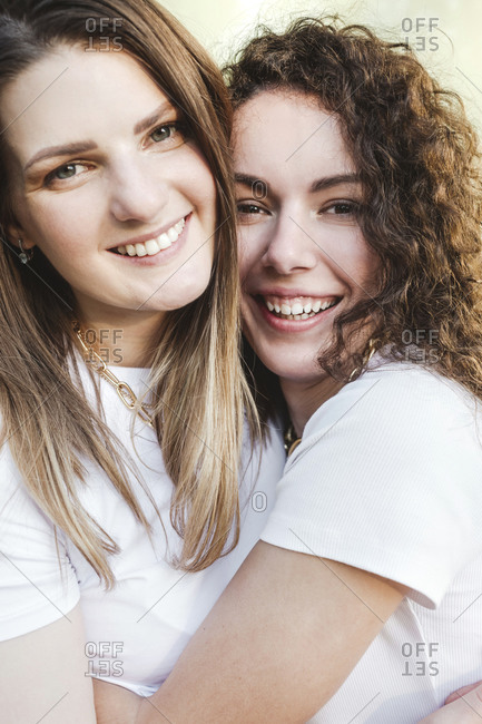 Happy female friends hugging each other