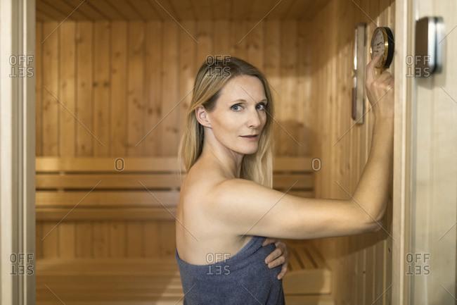 Beautiful woman in towel at sauna