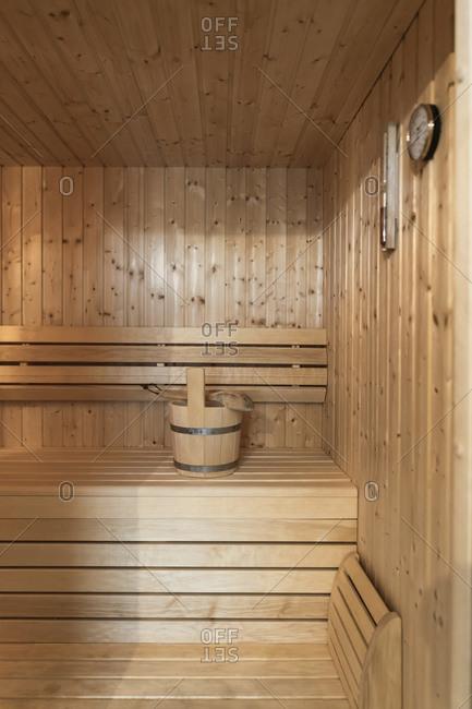 Bucket on seat in sauna