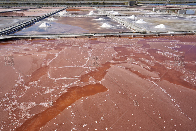 Pink waters of artificial salt lakes and ponds at Pomorie Lake used for extracting sea salt to make cosmetics, Pomorie, Bulgaria