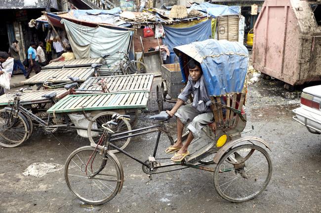 Dhaka, Bangladesh - April 26, 2013: A rickshaw driver on a crowded street in Dhaka