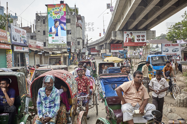 Dhaka, Bangladesh - April 28, 2013: Abundance of rickshaw drivers waiting for clients in the streets of downtown Dhaka city