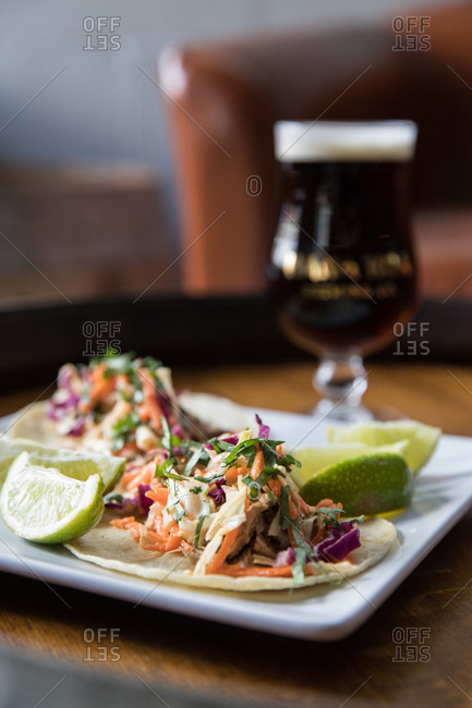 Tacos served with beer in a restaurant