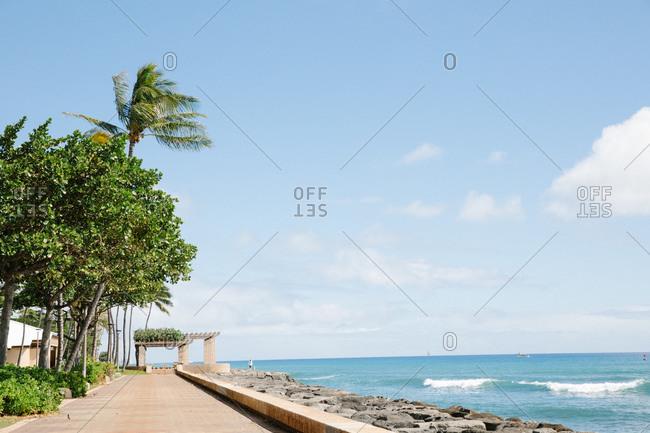 Rocks in front of promenade on the coast of Honolulu, Oahu, Hawaii