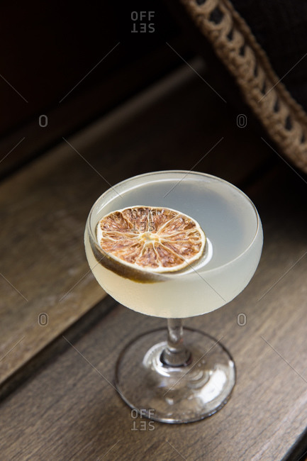 Elevated view of a cocktail in a couple glass garnished with citrus