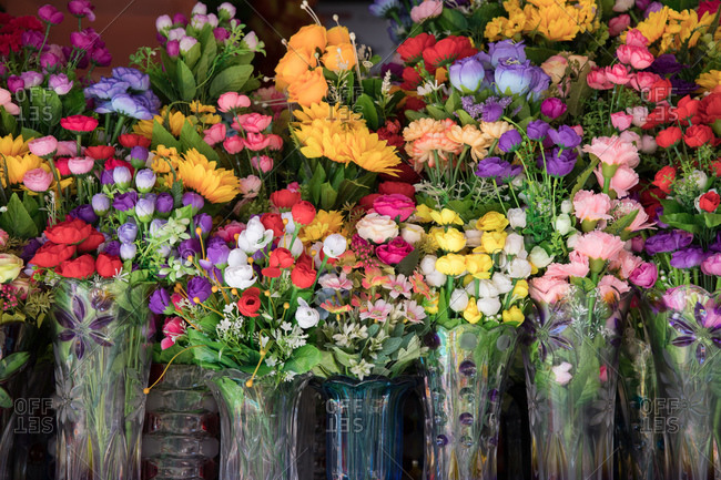 Variety of vibrant floral arrangements in glass vases