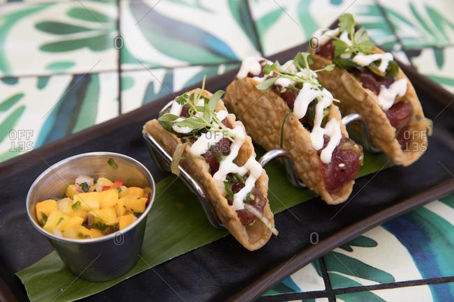 Ahi tuna tacos served on a table in a restaurant