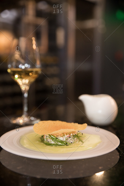 A decadent gourmet dish served with white wine in a restaurant