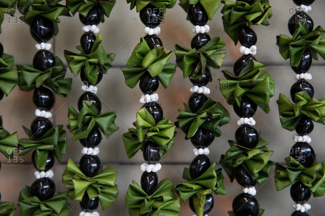 Leis made from shells, black kukui nuts and ti leaves