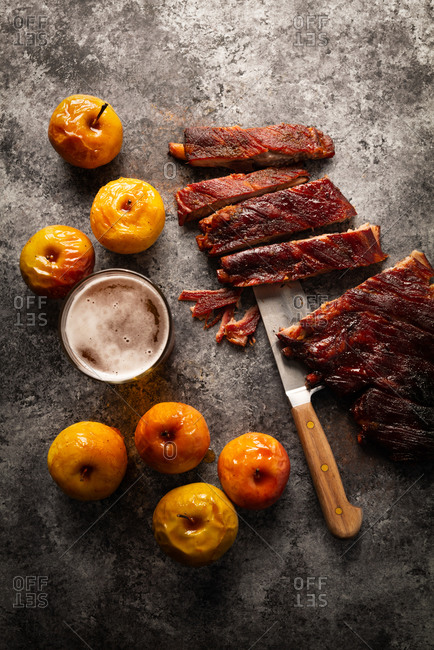 Apple cider ribs with roasted apples on gray stone surface