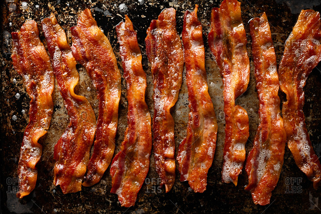 Oven baked bacon in a pan