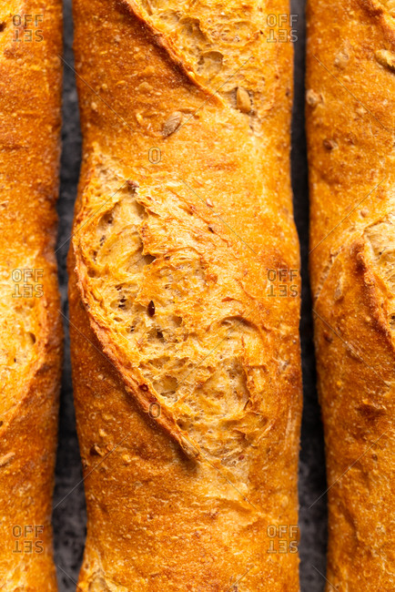 Fresh crispy baguettes from bakery close up