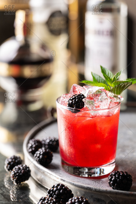 Blackberry bramble cocktail in a parlor
