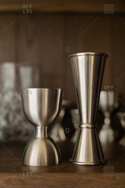 Cocktail jiggers on shelf display
