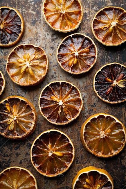 Dehydrated lemon and orange slices on sheet pan