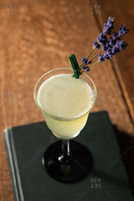 Green chartreuse and gin with lavender cocktail on a black book