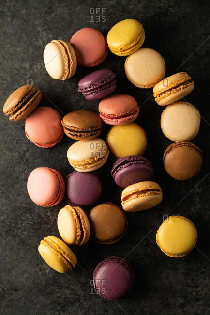 Macarons viewed from above on dark surface