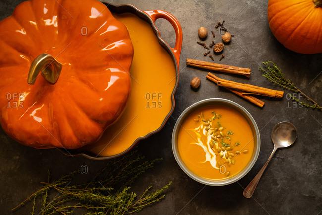 Overhead view of pumpkin soup from cast iron pot